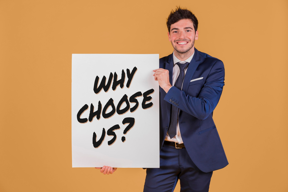 """boy smiling with a sign """"why choose us"""""""