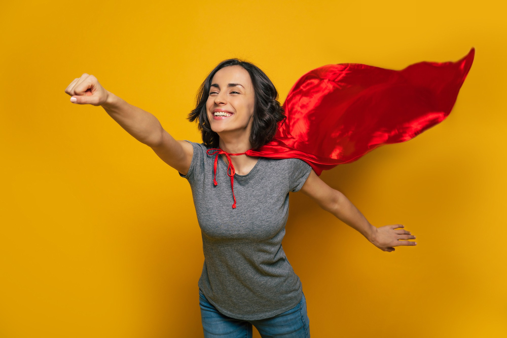 young woman pretending she is superwoman